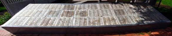 Мемориальные плиты с фамилиями. Левая часть.