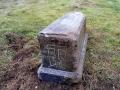Долгие годы могильный камень лежал под ворохом веток на сельском кладбище.