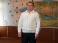 Предаватель А. И. Игнатьев читает стихотворение собственного сочинения.