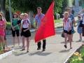 Вносят знамя районной пионерской организации Орлята.