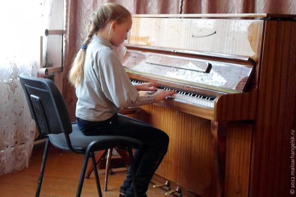 Ученица музыкальной школы.