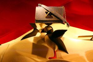 Сумка Louis Vuitton.